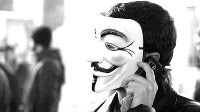Protestante Anonymous luchando por Wikileaks